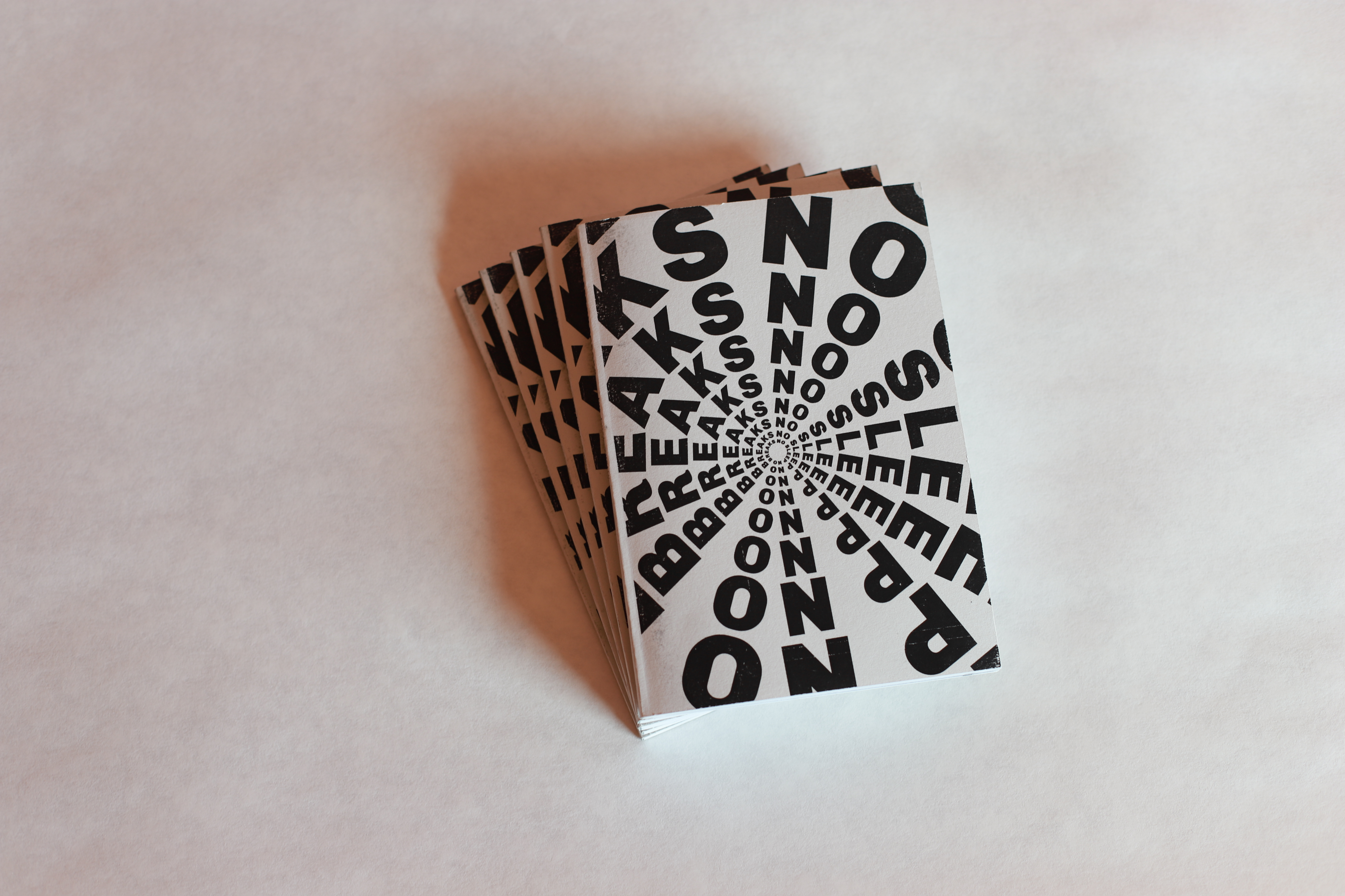 A small stack of NSNB zines.